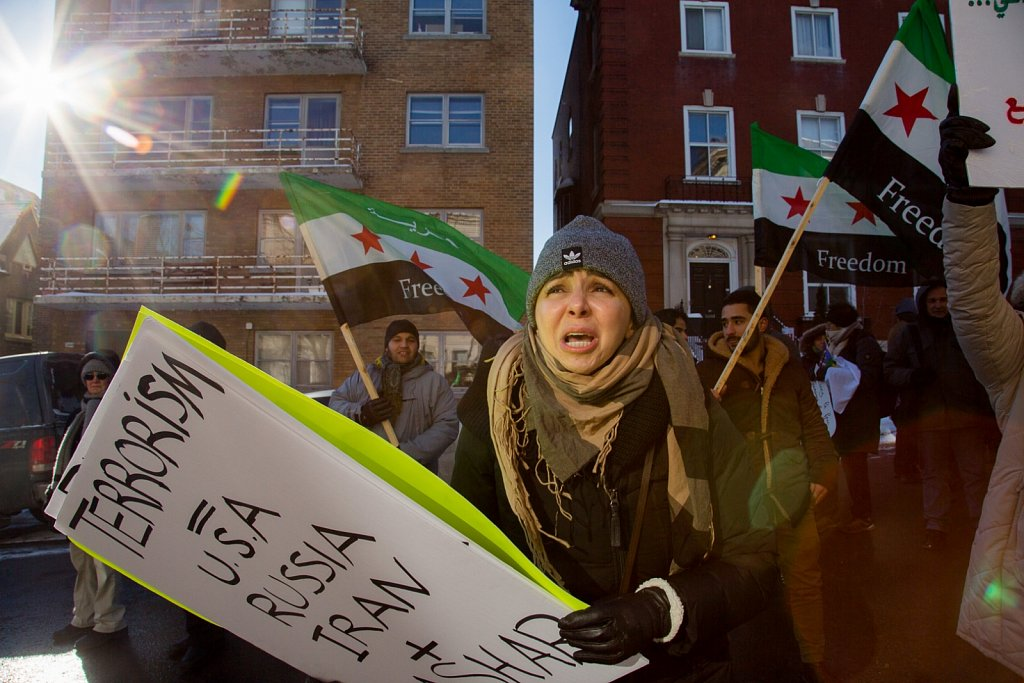 Syrians and supporters protest in front of the Russian Consulate in Montreal.